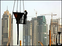 Construction worker and high-rise buildings, Dubai