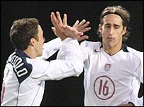 Josh Wolff (right) celebrates his goal at Hampden