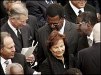 Prince Charles shakes hands with Robert Mugabe