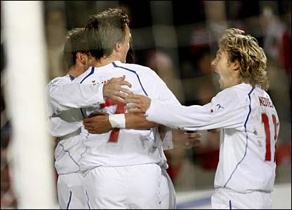 Karel Poborsky and Pavel Nedved celebrate with Vladimir Smicer