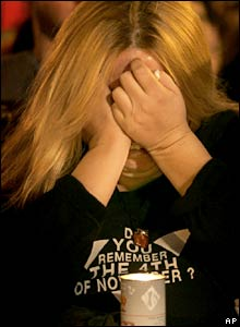A woman cries during the rally