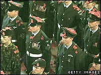 Servicemen covered in symbolic poppy petals