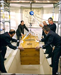 Pope John Paul II's coffin is lowered into the crypt of Saint Peter's Basilica