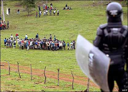 Riot policeman watches Indians in Caloto