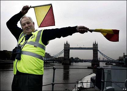 Ex Royal Navy Yeoman of the Signals David Goulden sends a semaphore message