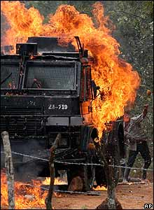 Police lorry burns as Indian hurls stone