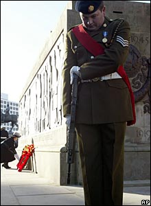 Soldier stands bowed in Liverpool