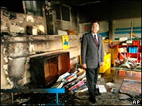 Carpentras mayor Jean-Claude Andrieu surveys the damage caused to the nursery school of La Cite Verte (The Green Housing Project)