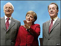 German Chancellor-designate Angela Merkel (centre) of CDU, SPD chairman Franz Muentefering (right), CSU chairman Edmund Stoiber (left)
