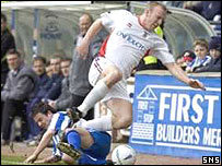 Ross Tokely is tackled by Killie's Stephen Murray