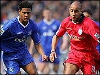 Chelsea's Glen Johnson (left) tussles with Birmingham's Medhi Nafti