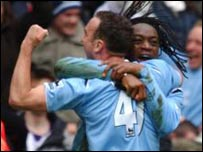 City goalscorer Kiki Musampa celebrates with Lee Croft