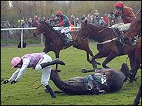 Joe Tizzard falls from Ad Hoc during the Grand National