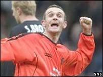 Jim McIntyre celebrates after equalising for United