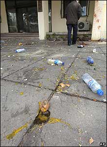 Empty water bottles and thrown eggs outside the Japanese embassy in Beijing