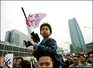 A Chinese boy holds a toy gun during an anti-Japanese rally in Beijing