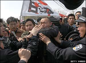 Protesters clash with police during an anti-Japanese rally in Beijing