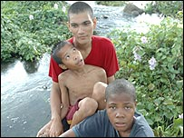 Jason (red shirt), son of a Mexican serviceman, a Filipino friend, and Stephanie Fragata, (bottom of picture), also the son of a serviceman