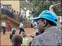 Kizza Besigye (in blue cap) at the police station