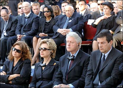 The Clintons sit between Rabin's son and daughter (front row), with US Secretary of State Condoleezza Rice and Israeli PM Ariel Sharon behind