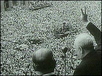 Winston Churchill signs to crowds on VE Day