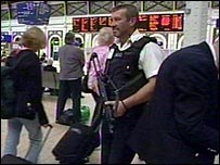 Armed police in a station