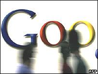 Google logo with people walking past