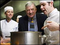 Sir Andrew Foster in college kitchen