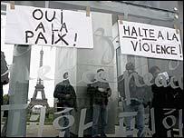 Anti-violence placards at the Champ de Mars Peace Monument in Paris, France