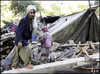 A Pakistani man amid the rubble of October's earthquake