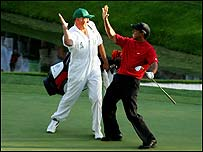 Tiger Woods and caddie Steve Williams celebrate on the 16th