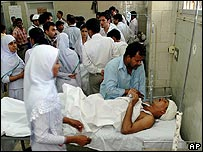 Injured people at a hospital in Karachi following a bombing