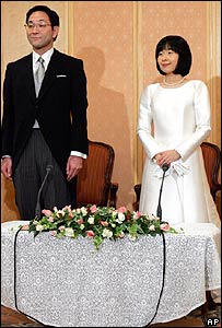 Sayako Kuroda and her husband Yoshiki Kuroda attend a press conference shortly after their wedding ceremony at a Tokyo hotel Tuesday, Nov. 15, 2005.