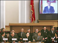 Kyrgyz lawmakers watch a recorded address to the nation of president Askar Akayev during a parliament session in Bishkek, Kyrgyzstan, Thursday, April 7, 2005.