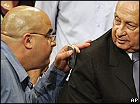 Omri Sharon (left) talks to father Ariel Sharon in the Knesset