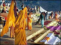 Pilgrims on banks of Narmada