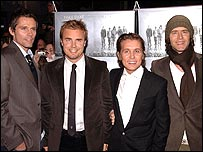Take That members Jason Orange, Gary Barlow, Mark Owen and Howard Donald