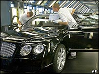 Volkswagen workers put finishing touches to a Bentley at its Dresden factory