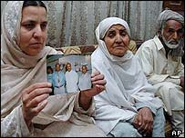Relatives of Malik Mohammed Javed with his photo