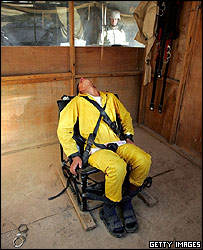 "An Iraqi detainee screams ""Allah"" while tied down in a ""humane restraint chair"" at the maximum security section of the Abu Ghraib Prison"