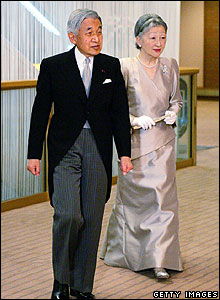 Japan's emperor and empress arrive at their daughter's wedding
