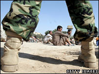 An Iraqi soldier guards Iraqi prisoners in Baghdad (file photo)