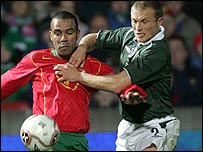 Portugal's Costinha and Warren Feeney of Northern Ireland