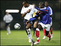 Darren Bent (left) in action during England's European Under-21 Championship qualifier against France