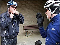 President Bush, left, talking with Mike Hammanwright during a break in a mountain bike ride in Quantico, Virginia