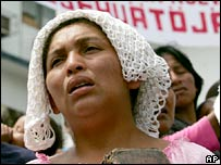 Venezuelan indigenous woman prays in a rally to back the New Tribes group last month