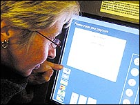 Photo of a woman looking at a VDU