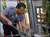 Firefighter cuts a chain at a kindergarten in Tel Aviv