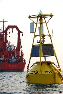 A tsunami detection buoy with the German research vessel Sonne in the background