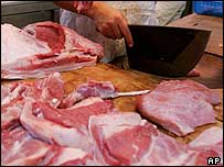 Pork being prepared by a butcher